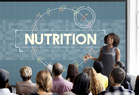 Woman presenting about nutrition Stock Photo