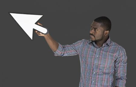 point and shoot: African descent man holding cursor