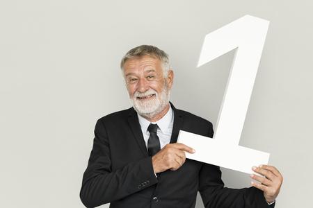 Senior businessman holding a one