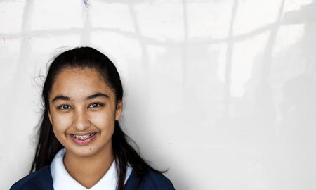 study: Portrait studio shoot of schoolgirl in uniform with smiling