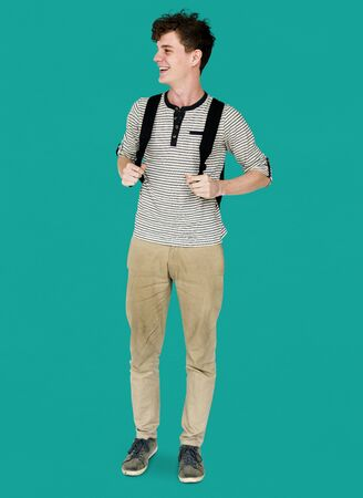 Young adult man smiling and carrying bag