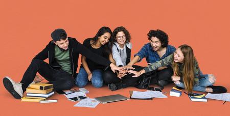 学生の手のグループを一緒に組み立てる 写真素材