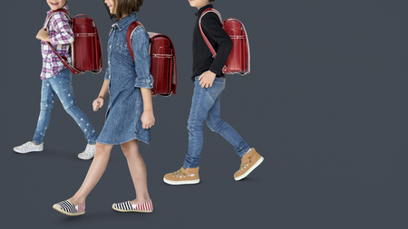 study: A group of children with a backpack Stock Photo