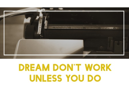 Dream Dont Work Unless You Do Word on Typewriter Background