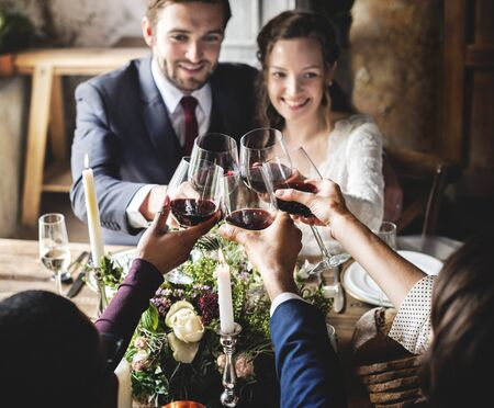 gather: People Cling Wine Glasses on Wedding Reception with Bride and Groom