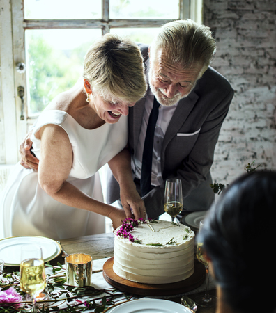 Newlywed Couple Hands Cutting Cake Together