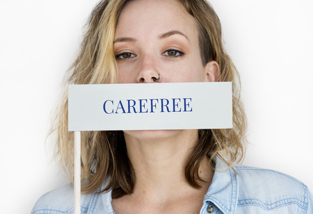 covering eyes: Woman holding banner network graphic overlay