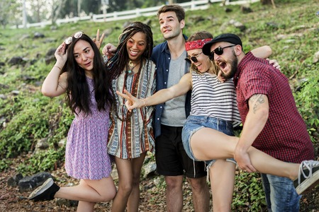 to spend: Group of Diverse Friends Having Fun Together