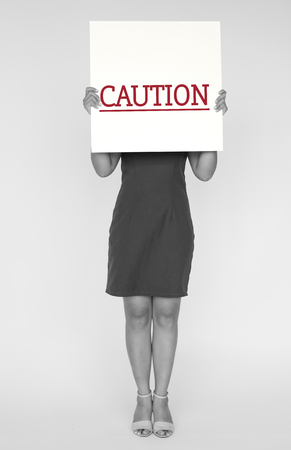 banned: Woman hold caution alert sign