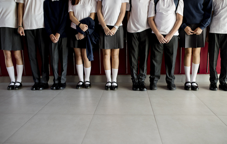 Group of students standing together on the hallway