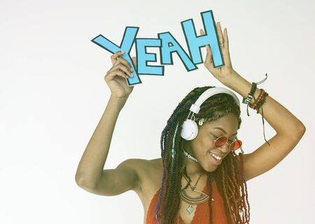 African woman smiling and holding papercraft with the word yeah Stok Fotoğraf