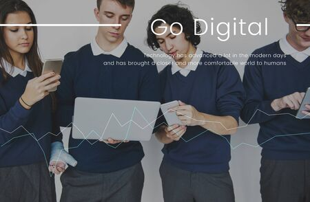 advancement: Students working on digital devices network connection graphic Stock Photo