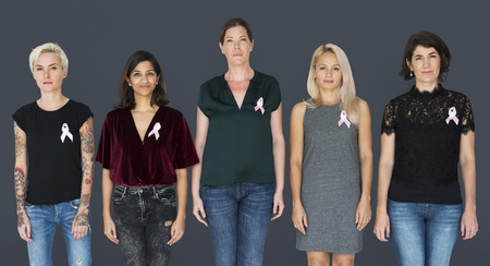 Group of women with pink ribbon for breast cancer awareness campaign