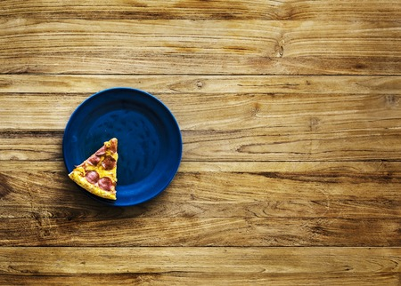 Last Piece of Pizza on Plate Stock Photo