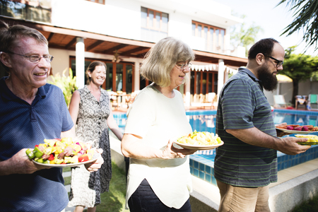 Group of people bring the food for the party