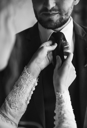 vistiendose: Bride Helping Groom Dressing Up for Wedding Ceremony
