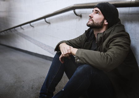 Adult Man Sitting Hopeless on The Floor
