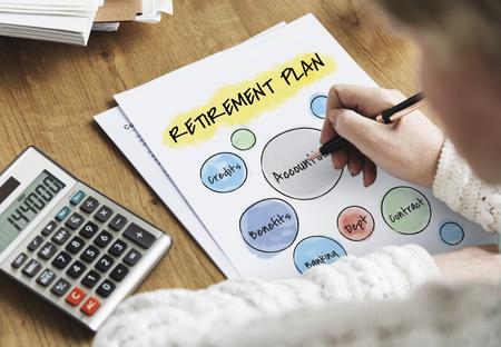 Woman writing on paper with retirement plan concept Фото со стока