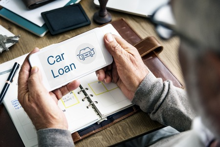 borrowing: Car Loan Icon on the Screen of mobile device Stock Photo