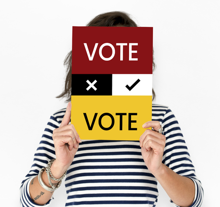 Woman hold vote card cover her face Banco de Imagens