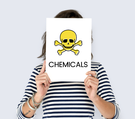 People holding placard with skull icon and chemicals dangerous Banco de Imagens