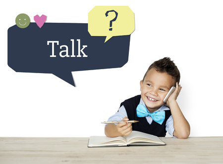 faq's: Boy using mobile phone talking and smiling