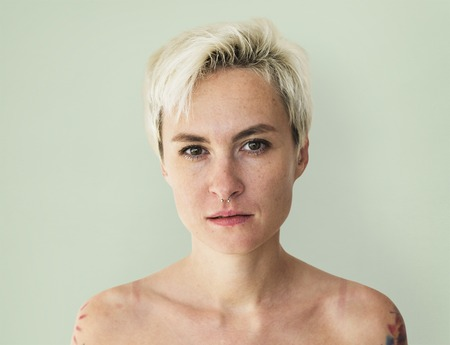 Portrait of shirtless woman looking at camera