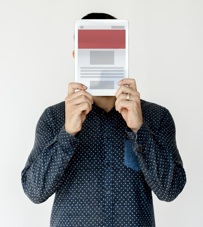 Man holding network graphic overlay digital device covering face Stock Photo - 81237584