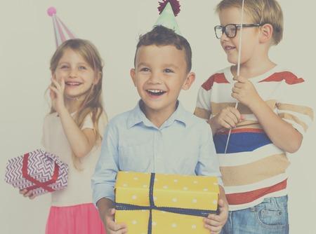 spolužák: Group of kids with gift for birthday party Reklamní fotografie