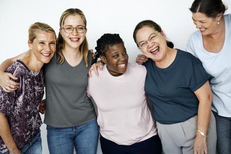 チームワークの笑みを浮かべて女性フェミニズム一体のグループ 写真素材
