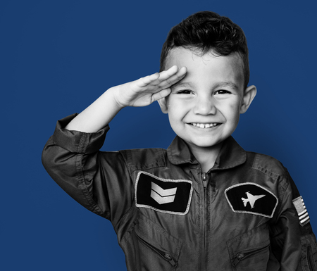 Little boy with pilot dream job salute and smiling Banco de Imagens - 81107435