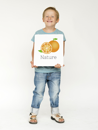 Boy with Illustration of fresh organic orange Stock fotó