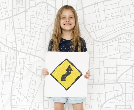 the roadside: Young girl holding network graphic overlay banner