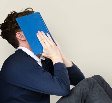 exhausting: Man stressed and tried with reading exam Stock Photo