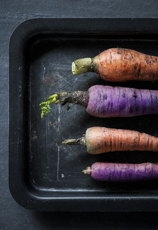 Fresh raw carrots in a tray Banco de Imagens