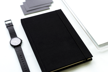 Black notebook and watch on the desk 版權商用圖片
