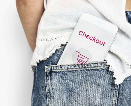 Network graphic overlay digital device in jeans pocket