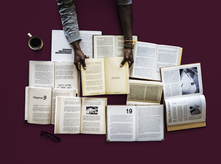 Human hand holding and reading book for research Banco de Imagens - 81132846