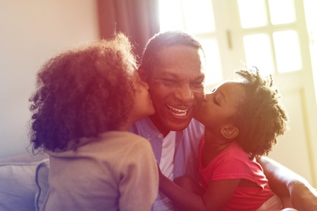 smooch: Daughters Kisses Father Morning Happiness Stock Photo