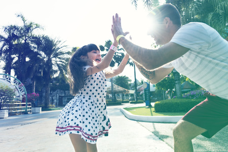 Family Father Daughter Togetherness High FIve Stock Photo