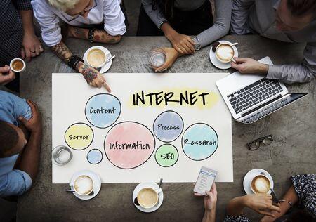 Workers working on billboard network graphic overlay on table 版權商用圖片