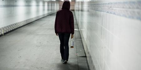 Drunk lonely woman walking alone