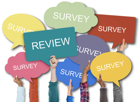 People holding speech bubbles with review and survey concept Stock Photo