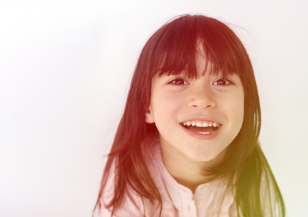 Young girl making facial expression Stock Photo