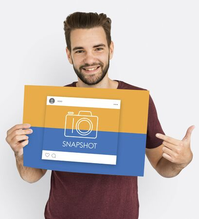 Man showing a placard with snapshot concept