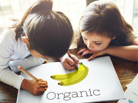 Children with illustration of fresh organic delicious banana Banco de Imagens
