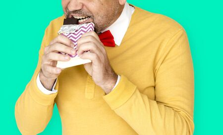 A Man Eatting Chocolate Like Really Hungry