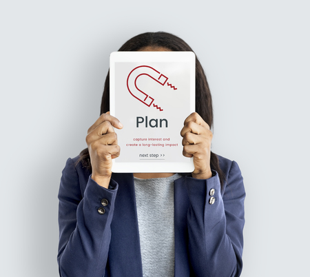 Woman holding digital device covering face network graphic overlay Imagens
