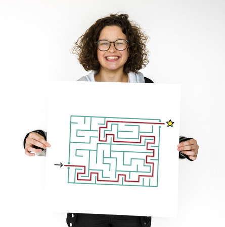 Woman hold a puzzle concept card Фото со стока