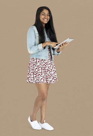 techie: Young indian woman standing and using digital tablet